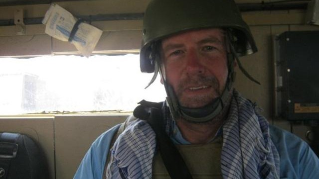 Sean Callebs rides in an Army vehicle in August, 2011, in Nimroz, Afghanistan, when he was working for the State Department.