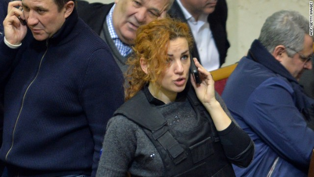 Deputy of the opposition party Batkivshchyna (Fatherland), Lesya Orobets wears a bulletproof vest during an extraordinary session of the Ukrainian parliament on January 28, 2014 in Kiev.