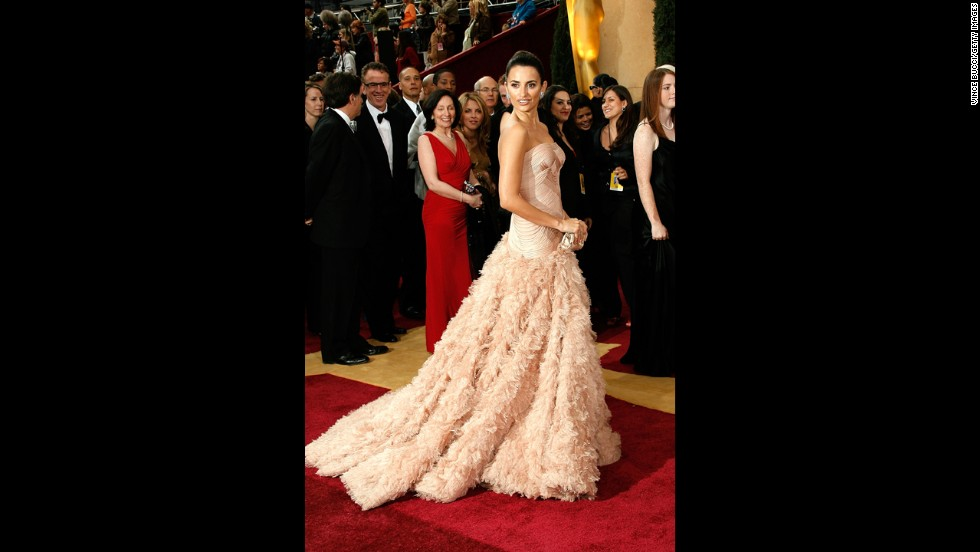 "At the 2007 Oscars, when Penelope Cruz was nominated for best actress in ""Volver,"" the star took a risk with a floor-length feathered gown from Versace. With its blush color, the dress won everyone over with its combination of drama and romance."