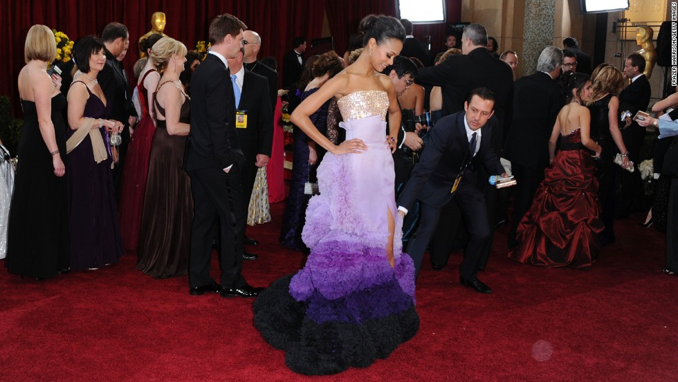 "The ombre hue of Zoe Saldana's 2010 Oscars gown wasn't the only thing unusual: There was the glittering bodice and the skirt that held layer upon layer of ruffles, plus a thigh-high slit. The Givenchy couture number was the very definition of ""risk,"" but it paid off handsomely in praise for the actress."