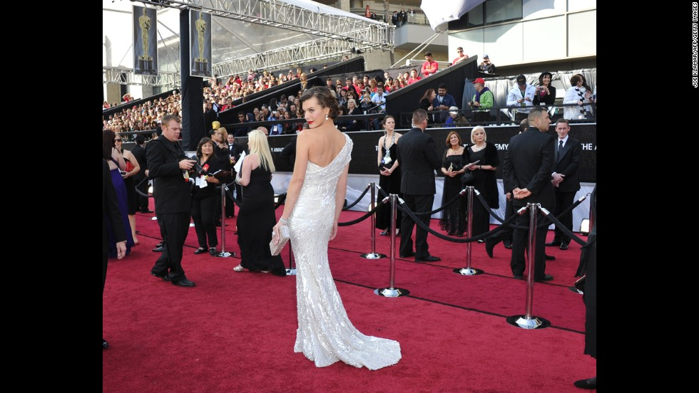 "As Milla Jovovich proved at the 2012 Oscars, you don't need to be a nominee to steal the show. The ""Resident Evil"" actress looked like she'd been poured into her white Elie Saab gown, and her retro hairdo recalled old Hollywood at its finest."