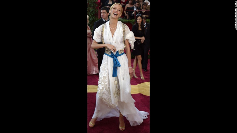 """When Uma Thurman attended the Oscars in 2004, she was smack in the middle of promoting Quentin Tarantino's """"Kill Bill Vol. 2."""" Critics probably would've gone easier on her had she worn her character's famous yellow bodysuit instead of this """"Heidi""""-esque costume of a dress."""
