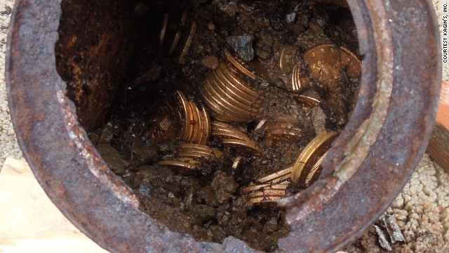 Decaying metal canisters filled with 1800s-era U.S. gold coins were unearthed in California by two people who wish to remain anonymous.