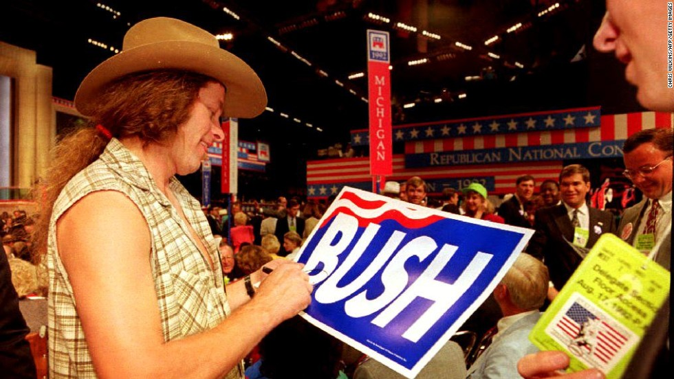 "Nugent signs an autograph on the Astrodome floor during the 1992 Republican National Convention. Nugent worked with MTV's ""Rock the Vote"" campaign."
