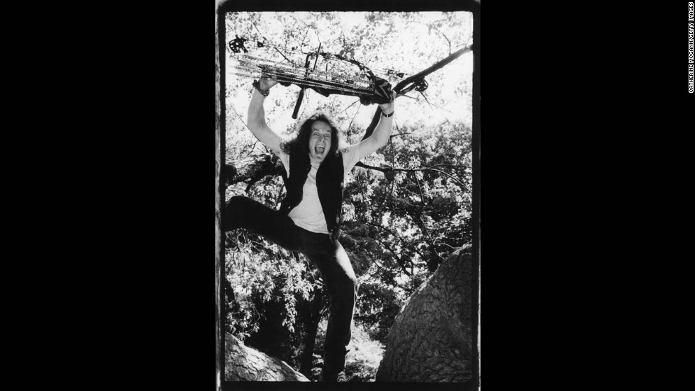 Nugent holds a crossbow over his head in New York's Central Park in 1993. Nugent served as a county sheriff in his native Michigan and became an advocate for gun rights, hunters and conservation.