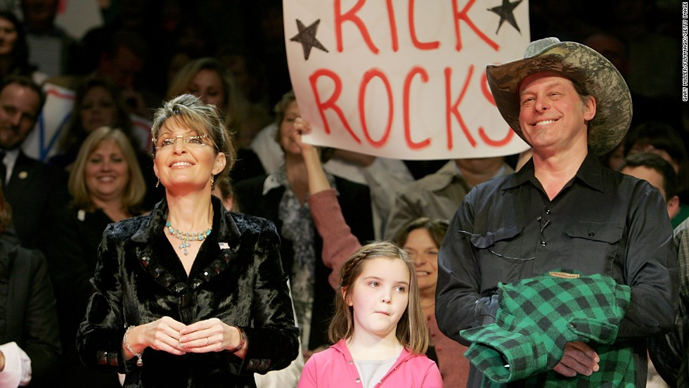 In recent years, Nugent has appeared with Republicans at their campaign events. Here, Nugent appears with former Alaska Gov. Sarah Palin and Palin's daughter Piper at a rally for Texas Gov. Rick Perry in 2010.