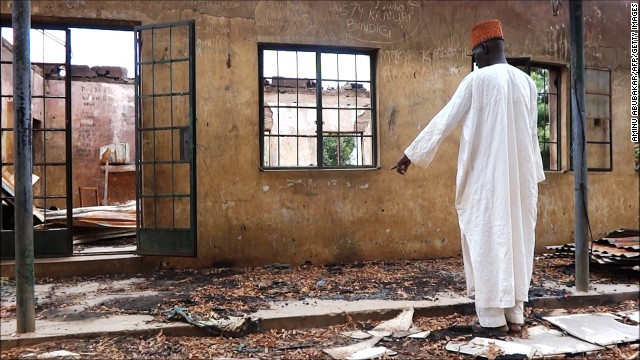 A staff inspects on August 6, 2013 a burnt student hostel in the Government Secondary School of Mamudo in northeast Nigerian Yobe state where Boko Haram gunmen launched gun and explosives attacks on student hostels on July 6, 2013, killing 41 students and a teacher, the group's dealiest in its wave of attacks on schools as part of its armed campaign to establish an Islamic state in the West African nation. Gunfire and explosions shook one northeastern Nigerian town on August 6, 2013 while soldiers slapped a round-the-clock curfew on another in the region hit by waves of insurgent attacks, the military and residents said. Clashes broke out in the town of Gamboru Ngala on the border with Cameroon on Monday night and continued on Tuesday, a resident said. The military had not commented on the situation there and details remained unclear. AFP PHOTO / AMINU ABUBAKAR (Photo credit should read AMINU ABUBAKAR/AFP/Getty Images)