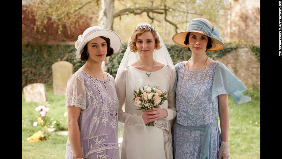 Lady Edith's wedding dress, center, was built around a vintage embroidered panel, with present-day embroidery added to the dress created around it, Eaton said.