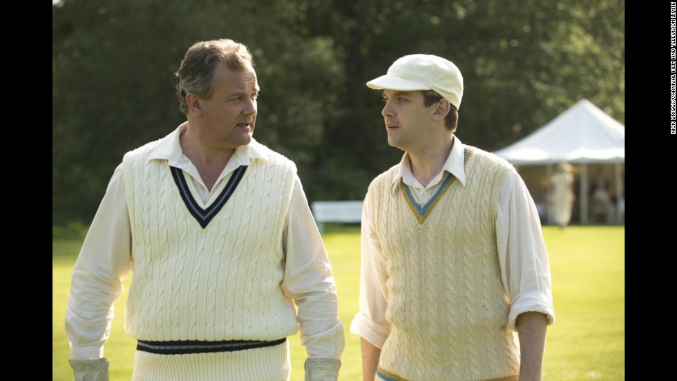 Lord Grantham and Matthew wear cable knit vests for a cricket match.