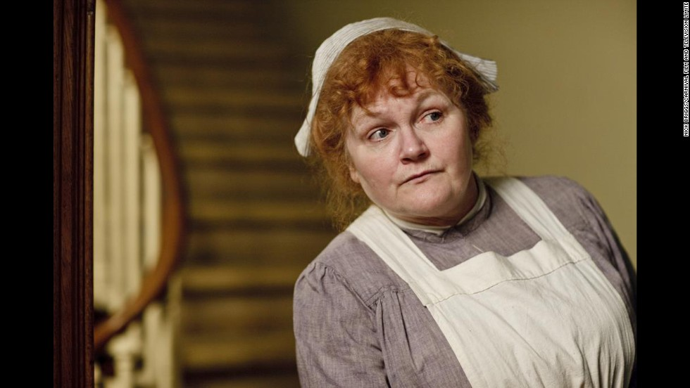 While women's fashions upstairs change quickly, servant's clothes like those worn by Mrs. Patmore remain much the same.