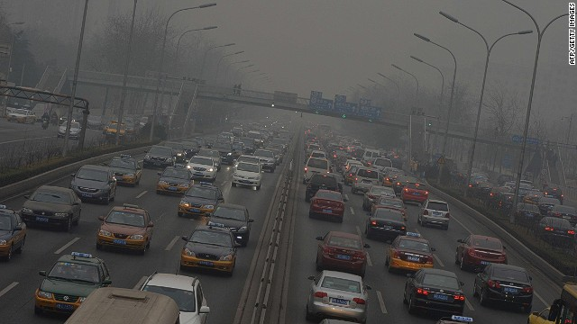 Traffic on the second ring road as heavy air pollution continues to shroud Beijing on February 26, 2014. Beijing's official reading for PM 2.5, small airborne particles which easily penetrate the lungs and have been linked to hundreds of thousands of premature deaths, stood at 501 micrograms per cubic metre. AFP PHOTO/Mark RALSTONMARK RALSTON/AFP/Getty Images
