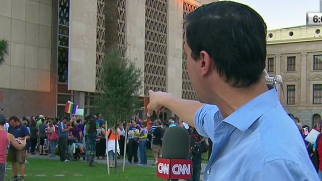 Protesters celebrate Arizona veto