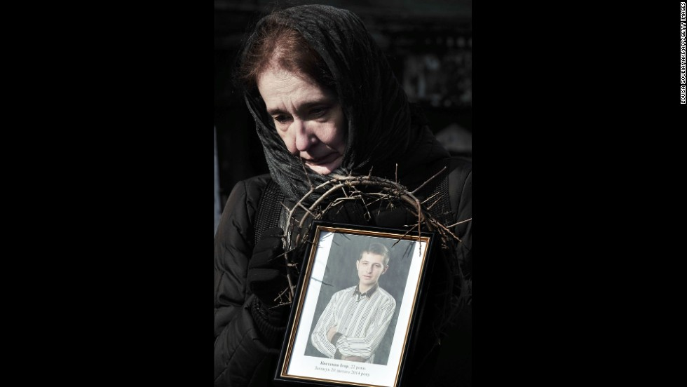 On February 26 in Kiev, a woman holds a photograph of a protester killed during the height of tensions.