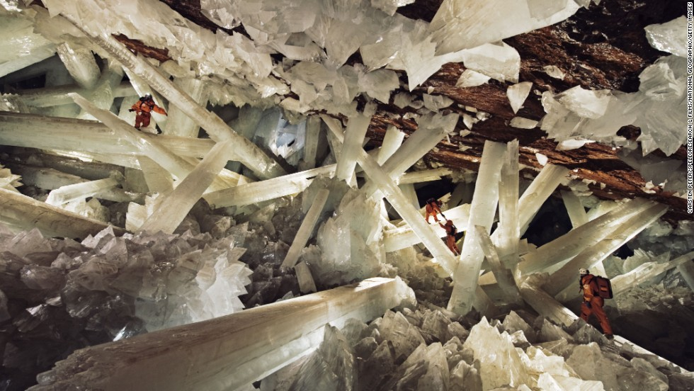 Massive beams of selenite dwarf explorers in the Cave of Crystals.