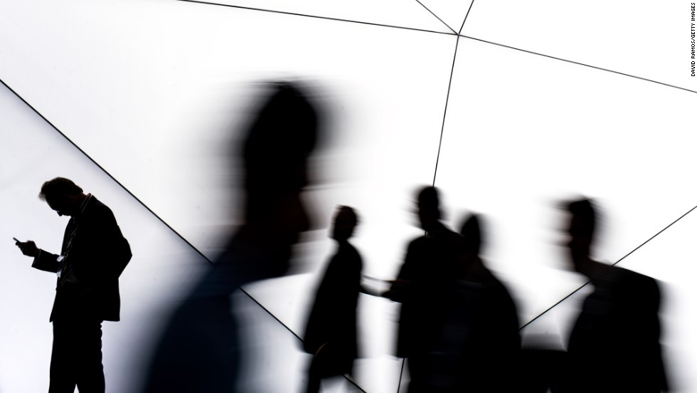 """Visitors walk past a Samsung stand Monday, February 24, during the first day of the Mobile World Congress in Barcelona, Spain. The annual Mobile World Congress hosts some of the world's largest communication companies, with many unveiling their <a href=""""http://www.cnn.com/2014/02/27/tech/mobile/mobile-world-congress-top-trends-smartphone/index.html"""">latest phones and gadgets</a> at the event."""