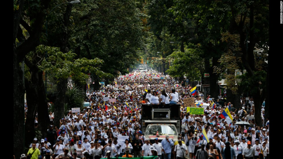 Women march to the National Guard headquarters in Caracas on February 26 to protest what they call excessive use of force against anti-government demonstrations.