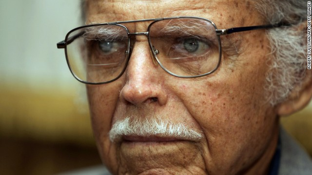 Miami, UNITED STATES: Former Castro Rebel Army comandante Huber Matos is interviewed in his office in Miami 19 July 2006. Matos served 22 years in one of Castro's prisons after resigning his command because of differences with the Cuban leader. AFP PHOTO/Robert SULLIVAN (Photo credit should read ROBERT SULLIVAN/AFP/Getty Images)