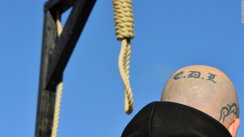 "A supporter of the far-right English Defence League stands by a replica of hangman's noose and gallows during a protest outside the Old Bailey courthouse in London on Wednesday, February 26. Two Islamic converts <a href=""http://www.cnn.com/2014/02/26/world/europe/uk-soldier-killing-sentencing/index.html"">convicted of killing a British soldier</a> on a London street last year were sentenced Wednesday, one to life in prison and the other to a minimum of 45 years."