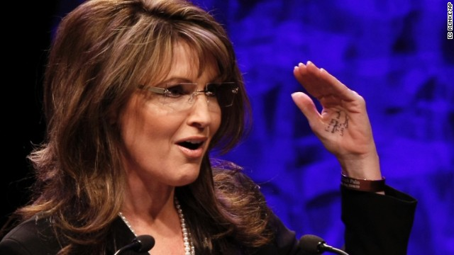 In this Saturday, Feb. 6, 2010 photo, former vice presidential candidate Sarah Palin addresses attendees at the National Tea Party Convention in Nashville. On her hand are seen some handwritten notes. (AP Photo/Ed Reinke)