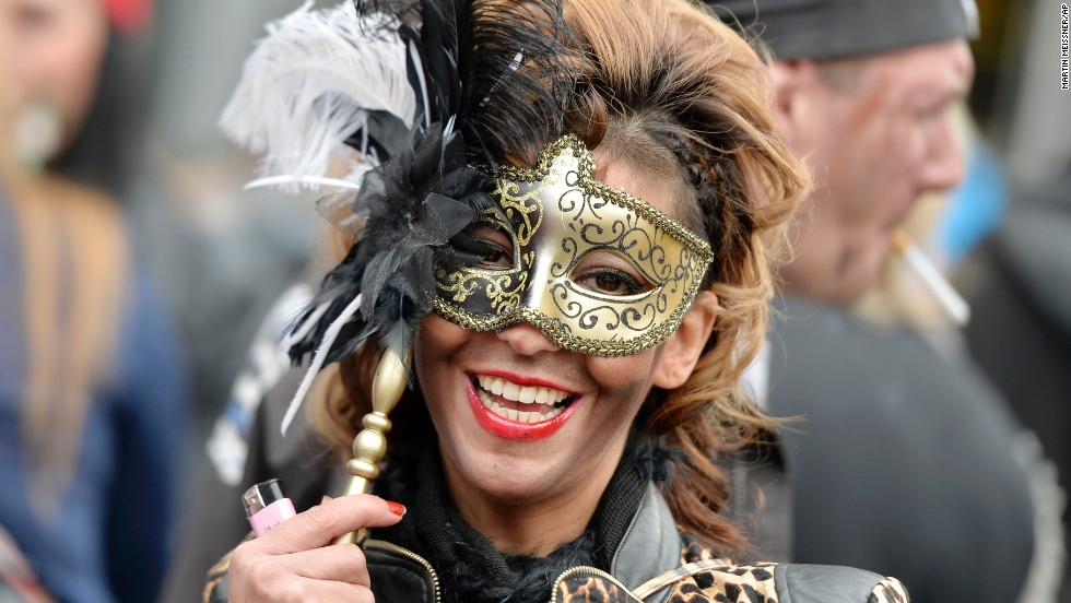 A woman joins tens of thousands of revelers to celebrate the start of a street carnival in Cologne on Thursday, February 27.