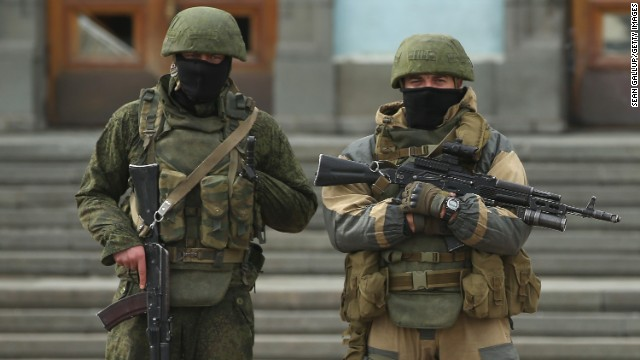 Heavily-armed troops displaying no identifying insignia and who were mingling with local pro-Russian militants, stand guard outside a local government building on Sunday, March 2, in Simferopol, Ukraine. The new government of Ukraine has appealed to the United Nations Security Council for help against growing Russian intervention in Crimea, where thousands of Russian troops reportedly arrived in recent days at Russian military bases there and also occupy key government and other installations. World leaders are scrambling to persuade Russian President Vladimir Putin to refrain from further escalation in Ukraine.