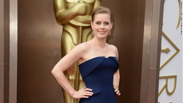 Nominee for Best Actress in 'American Hustle' Amy Adams arrives on the red carpet for the 86th Academy Awards on March 2nd.