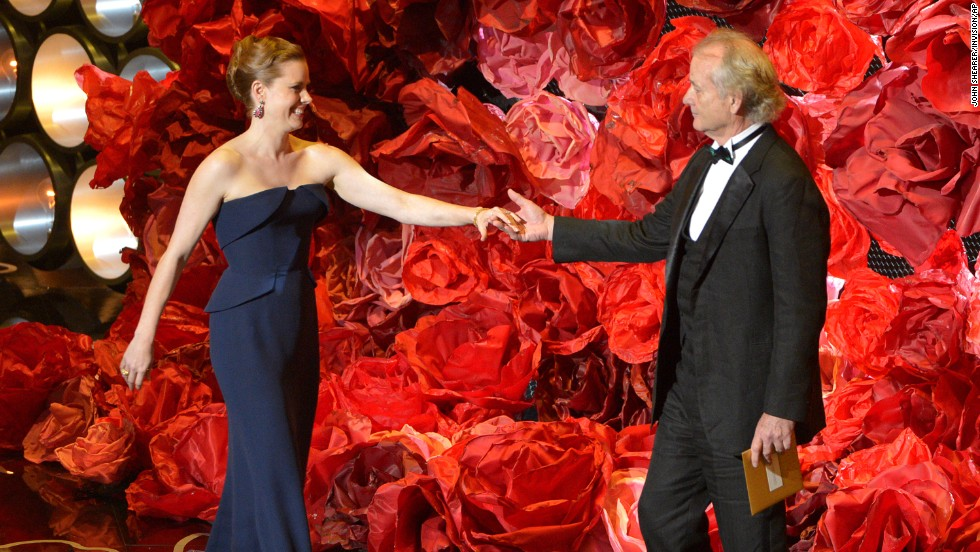 "Amy Adams greets Bill Murray on stage. While reading the names of those nominated for best achievement in cinematography, Murray also mentioned director <a href=""http://www.cnn.com/2014/02/24/showbiz/movies/obit-harold-ramis/index.html"">Harold Ramis</a>, his ""Ghostbusters"" co-star who died last month at the age of 69."
