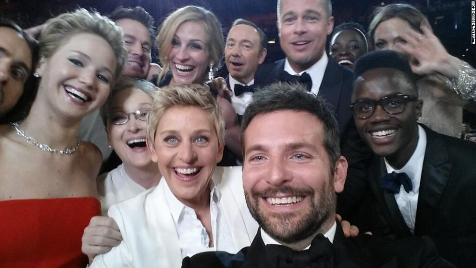 "DeGeneres takes a moment during the show to orchestrate a selfie with a group of stars. Bradley Cooper, seen in the foreground, was holding the phone at the time. ""If only Bradley's arm was longer,"" <a href=""https://twitter.com/TheEllenShow/status/440322224407314432"" target=""_blank"">DeGeneres tweeted</a>. ""Best photo ever."" It reportedly became the most retweeted post of all time."