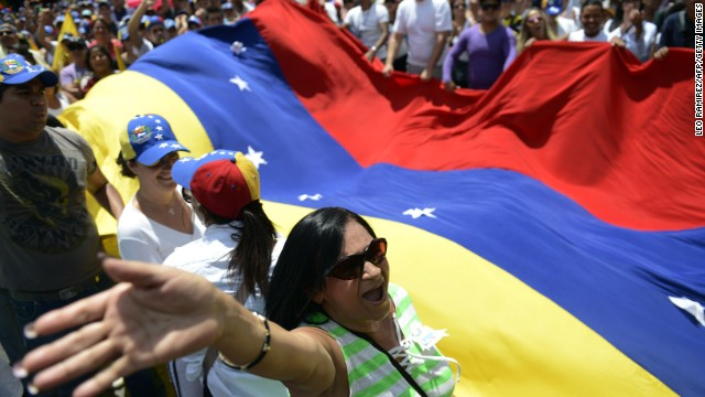 Opposition activists march in protest against the government of Venezuelan President Nicolas Maduro in Caracas on March 2.