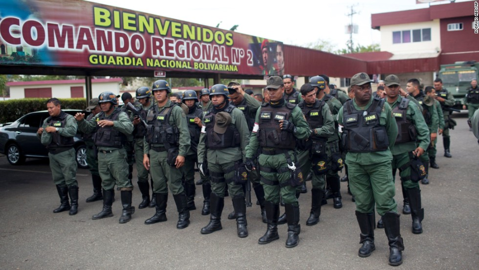 National Guard officers stand in formation after a patrol in Valencia, Venezuela, on Saturday, March 1.