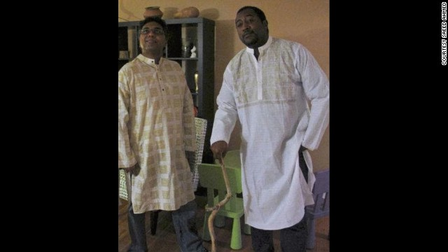 Mungin, right, poses with his friend and colleague Saeed Ahmed in the traditional attire of Ahmed's native Bangladesh.