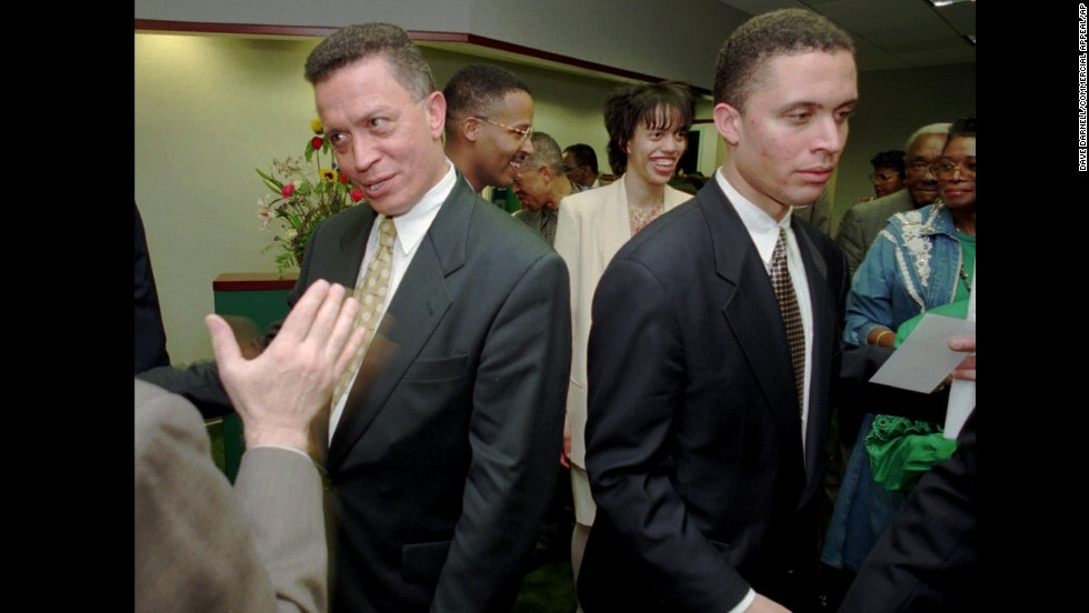 Then-Rep. Harold Ford, D-Tennessee, left, and his son, Harold Jr. shake hands with supporters in this 1996 photo. Harold Ford Sr. announced earlier that year that he was retiring from the seat he had held for 22 years and Harold Ford Jr. won the seat that fall.