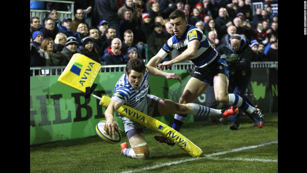 Joel Tomkins, a rugby player for Saracens, crashes into a flag post just short of the try line during a Premiership match against Bath on Friday, February 28, in Bath, England.