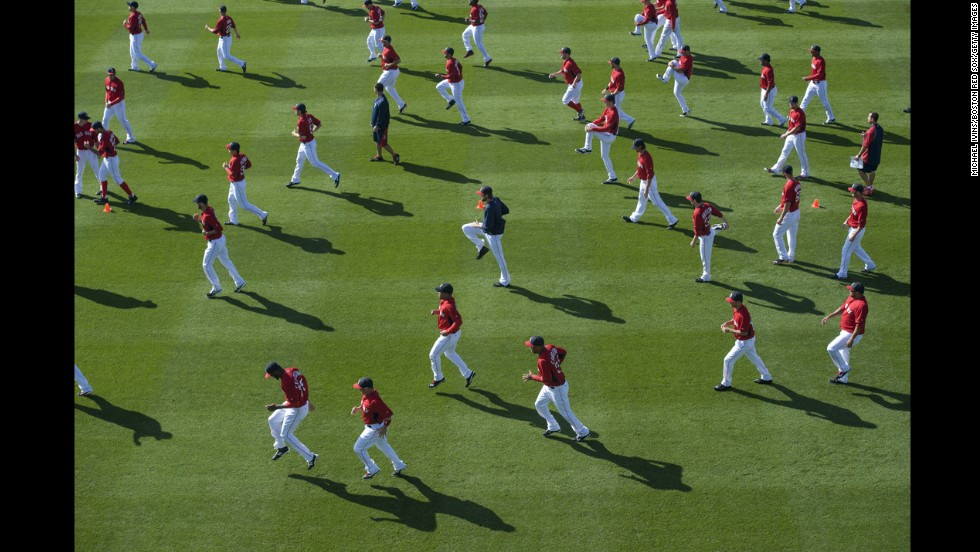 The Boston Red Sox warm up before a Grapefruit League game against the Minnesota Twins on Friday, February 28, in Fort Myers, Florida.