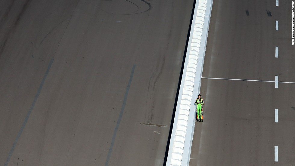 Race car driver Danica Patrick stands on pit road Friday, February 28, before NASCAR Sprint Cup qualifying at Phoenix International Raceway.