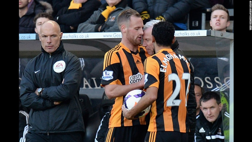 Alan Pardew, the manager of Newcastle United, headbutts Hull City's David Meyler during an English Premier League match Saturday, March 1, in Hull, England. Pardew was fined by his team and later charged by the Football Association for improper conduct.