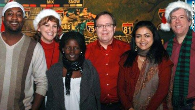 Mungin, left, poses with colleagues on the overnight shift at The CNN Wire at Christmas 2009.