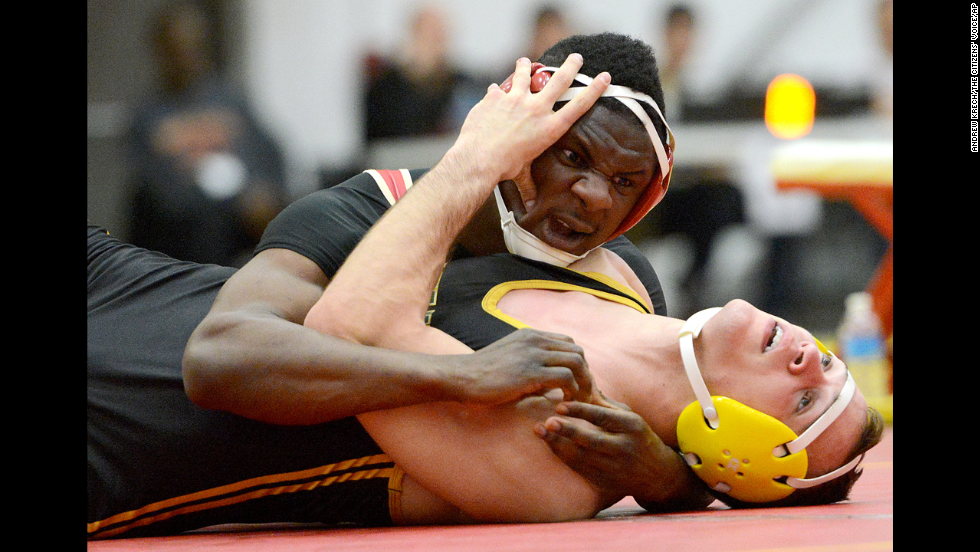King's College's Tommy Desir turns over Delaware Valley's Alec Horan during the NCAA Division III East Regional wrestling championships in Wilkes-Barre, Pennsylvania, on Sunday, March 2.