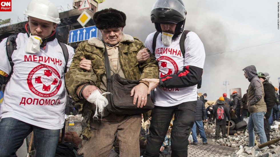 "Mikhaluk said that since the evening of February 18, a once peaceful <a href=""http://ireport.cnn.com/docs/DOC-1088436"">Euromaidan</a> had become a battlefield."
