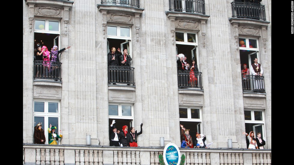 A costumed audience watches the Cologne parade from balconies on March 3.