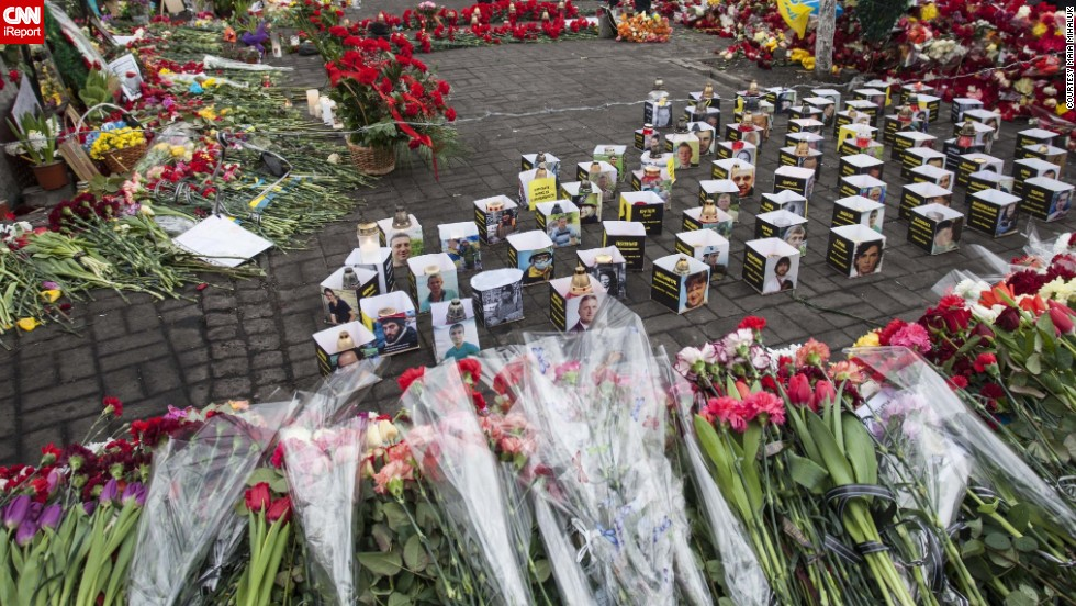 """People are still coming with <a href=""http://ireport.cnn.com/docs/DOC-1098749"">flowers</a> and grieving for the heroes who laid their lives for free Ukraine. The streets are like rivers of flowers,'"" Mikhaluk said."