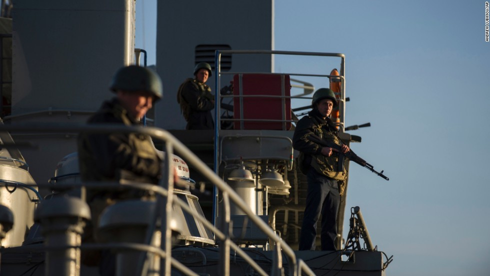 Ukrainian seamen stand guard on the Ukrainian navy ship Slavutych in the Sevastopol harbor on Monday, March 3.