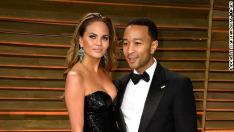 Chrissy Teigen and John Legend have a twinsies moment at the Vanity Fair Oscars after party.