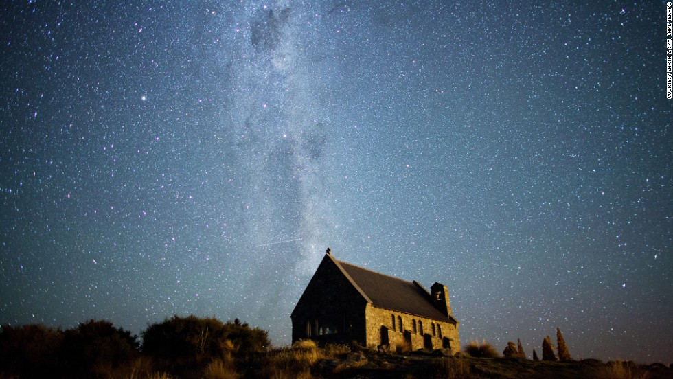 Looking south from Lake Tekapo, on the South Island in New Zealand, you can see the Milky Way stretching over the Church of the Good Shepherd. The Southern Cross and the Coal Sack Nebula are visible near the top of the image.