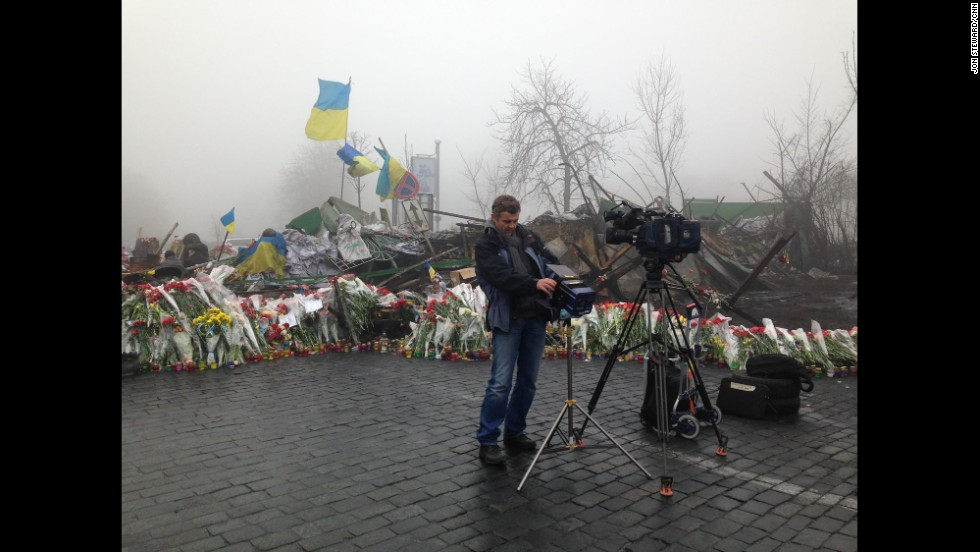 KIEV, UKRAINE:  CNN Cameraman Christian Streib sets up for live shots by the barricades on the road to Independence Square on March 4.  Photo by CNN's Jon Steward.