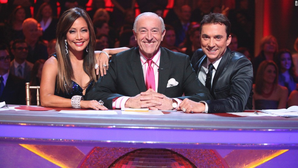 Sharp-tongued judge Len Goodman, center, who took season 21 off, is back, joined by returning judges Carrie Ann Inaba and Bruno Tonioli.