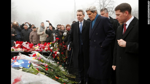 U.S. Secretary of State John Kerry visits a shrine for people killed during the protests in Kiev, Ukraine, on Tuesday, March 4.