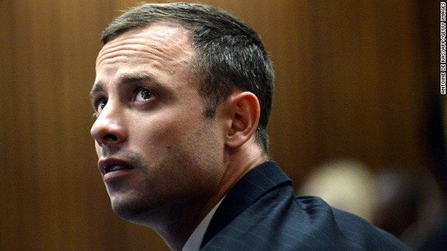 South African Paralympic athlete Oscar Pistorius, accused of murdering his girlfriend, looks on before court proceedings on the second day of his trial at the North Gauteng High Court in Pretoria, South Africa, on March 4, 2014.