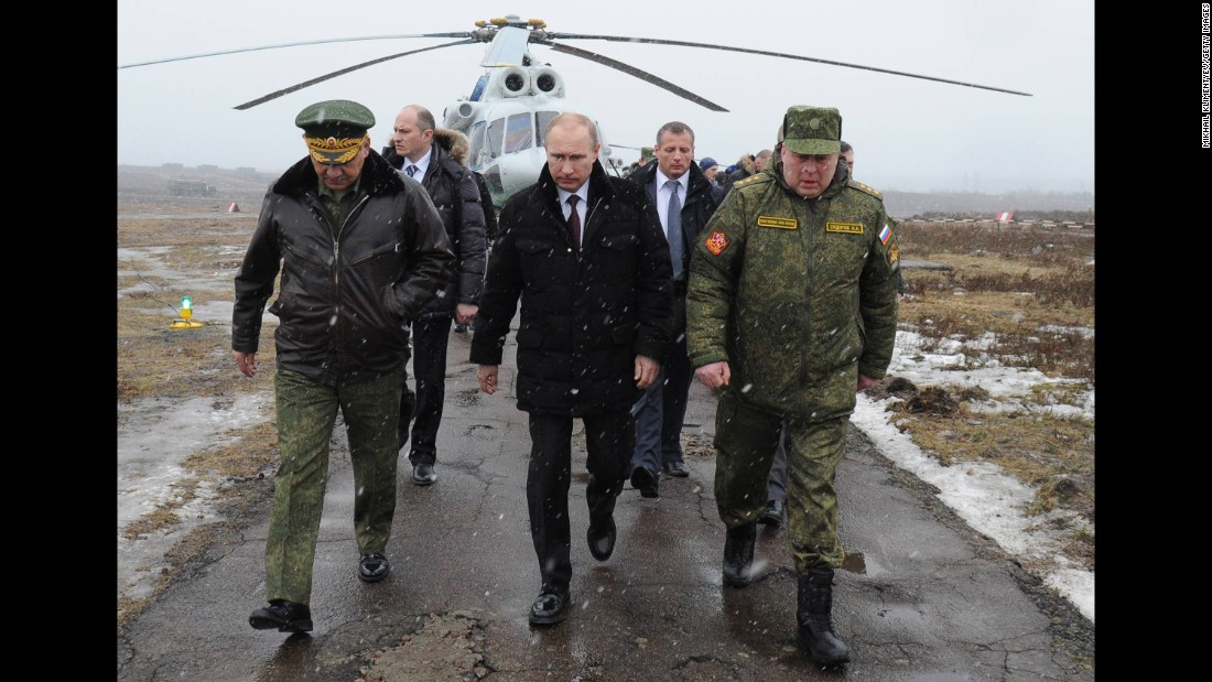 Putin arrives to watch a military exercise in Russia's Leningrad region in March 2014.