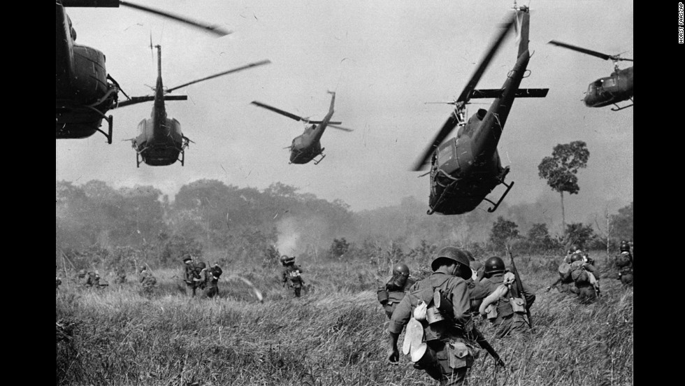 Hovering U.S. Army helicopters pour machine gun fire into the tree line to cover the advance of South Vietnamese ground troops in an attack on a Viet Cong camp northwest of Saigon, near the Cambodian border, in March 1965. The Vietnam War lasted nearly a decade and left more than 58,000 Americans dead.